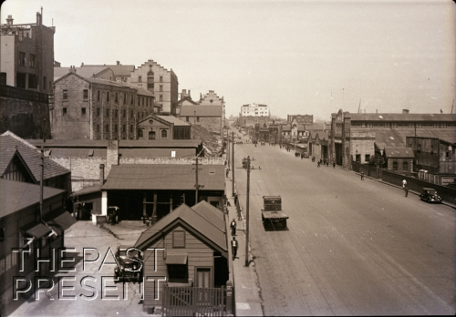 View south from High St. steps along Hickson Road at Union Co. #5 dock showing restriction of wharf frontage by high cliffs paralleling Darling Harbor. Warehouses Etc. on upland.