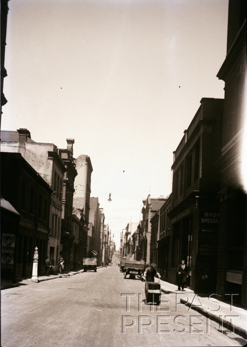 Little Bourke St. south from Russell (Chinese with cart in fore). Chinese quarter along this street and its inferior quality seen easily (taken from original captioning information)